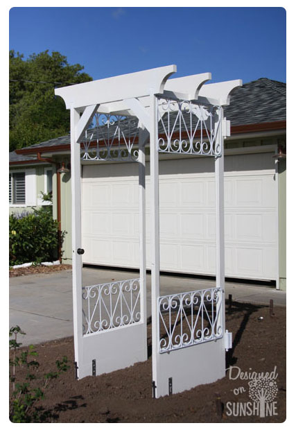 Using decorative screen doors instead of wood doors can give an arbor a bit more of an elegant look like this one from Designed on Sunshine. & 11 Gorgeous Garden Arbors Made From Old Doors - Off Grid World