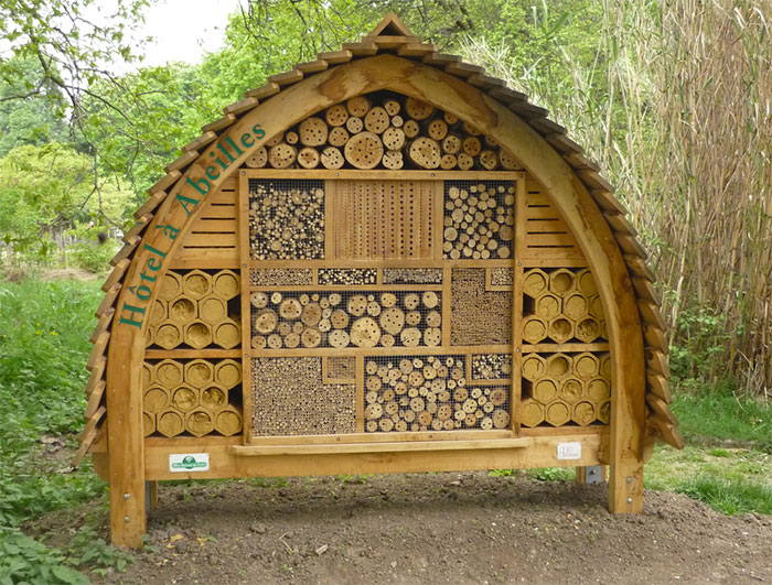 Big bee hotel in a park