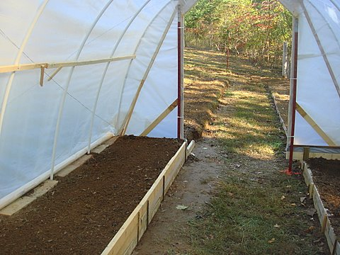 Raised beds in a hoop greenhouse