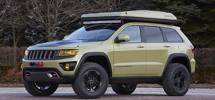 This sharp off-road beast has a two-person tent on top of the roof. It is housed in a built-on clam shell container. & The Amazing Jeep Grand Cherokee Overland [PICS]
