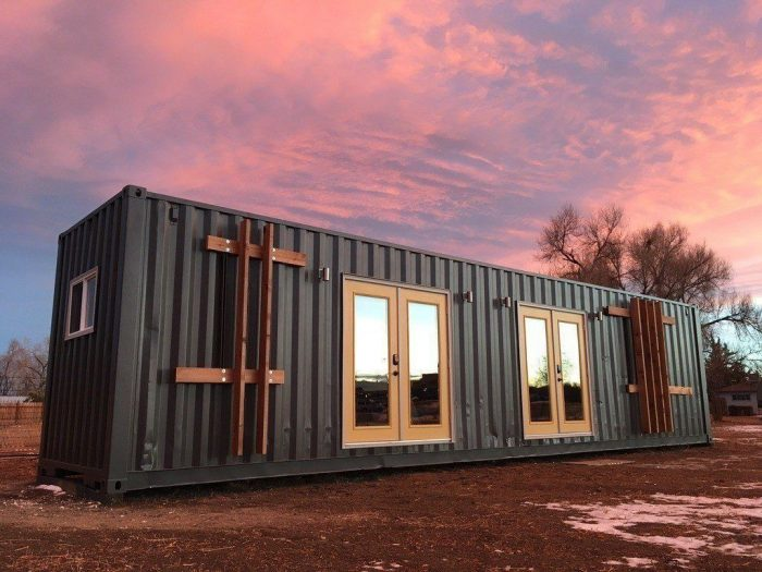 the tiny home is sleek modern design in container